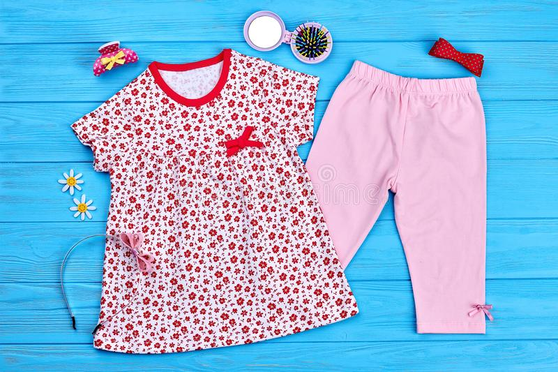 Infant baby summer fashion background. Toddler girl cotton apparel and hair accessories. New brand summer garment for infant girl, top view royalty free stock photo