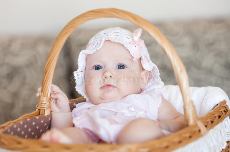 Infant In The Basket Royalty Free Stock Photo