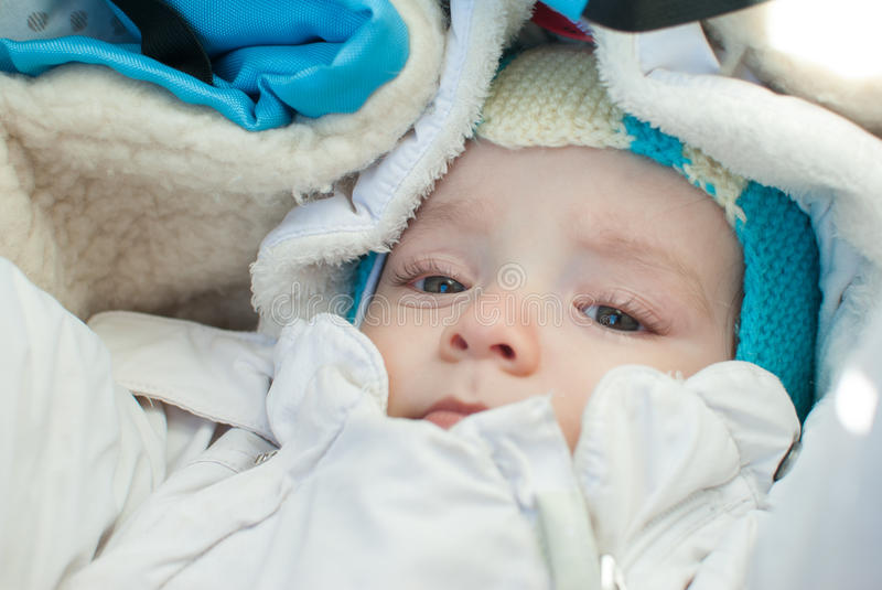 Infant boy on a winter walk stock photos