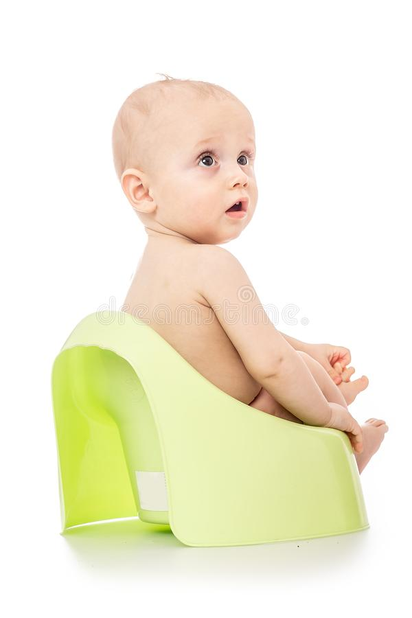 Infant child baby boy toddler sitting on potty toilet isolated on a white background. spoiled kid concept. teach a child to the. Pot royalty free stock images