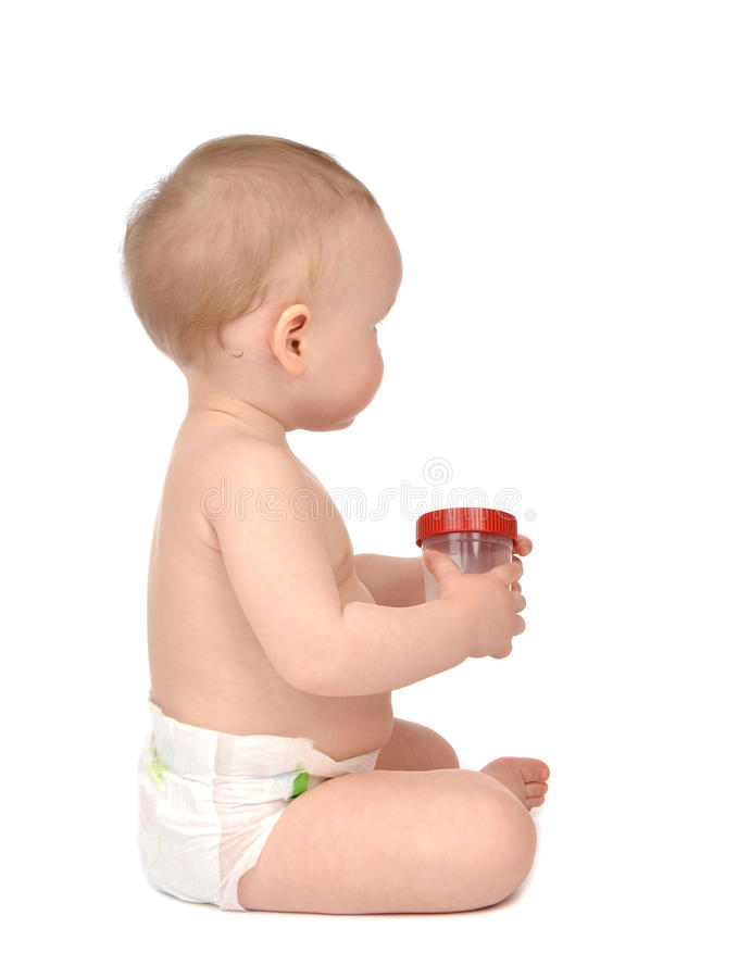 Infant child baby girl in diaper sitting backward with empty plastic sample can for analysis royalty free stock photos