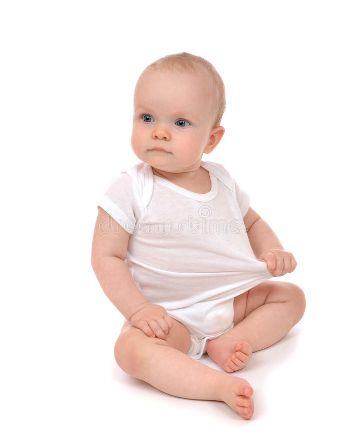 Infant child baby girl in diaper sitting and happy looking at th royalty free stock photography