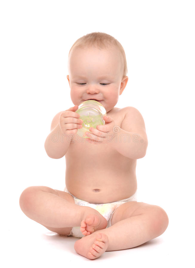 Infant child baby toddler sitting and drinking water from the fe stock photo