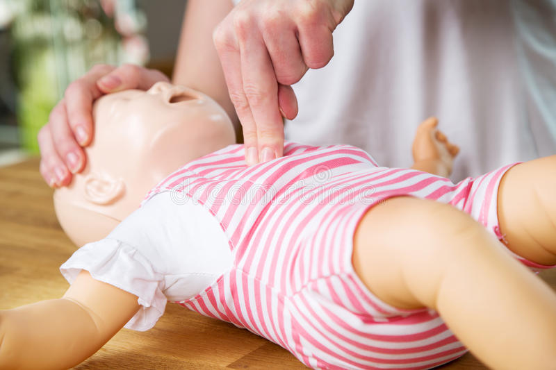 Infant CPR two finger cvompression royalty free stock images