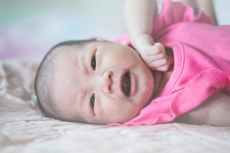 The infant is crying and lying royalty free stock photos