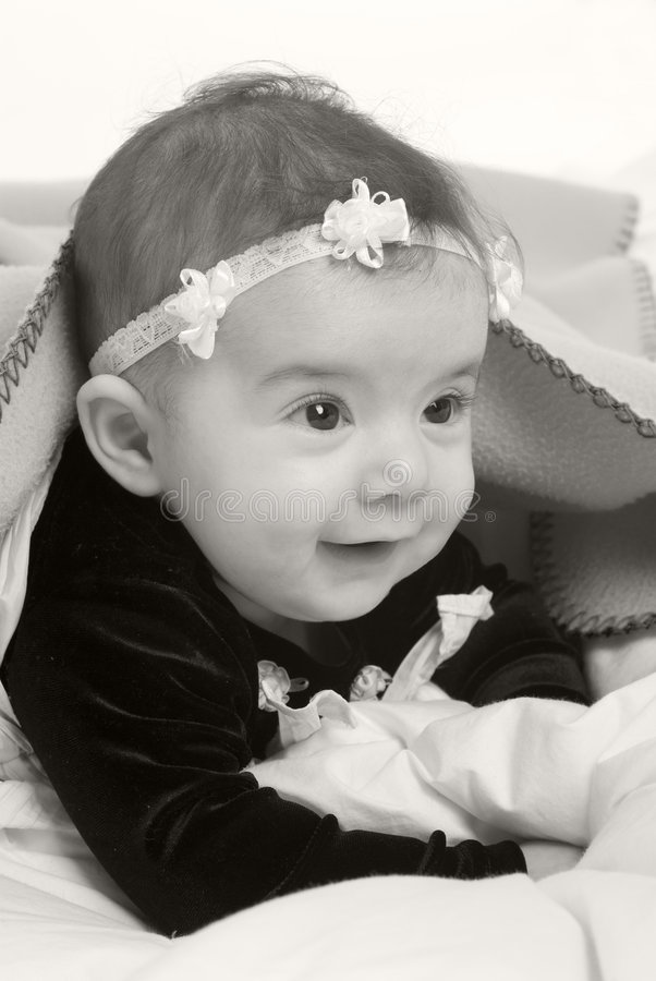 Infant Girl. A young infant girl. Childhood, babies, family stock image