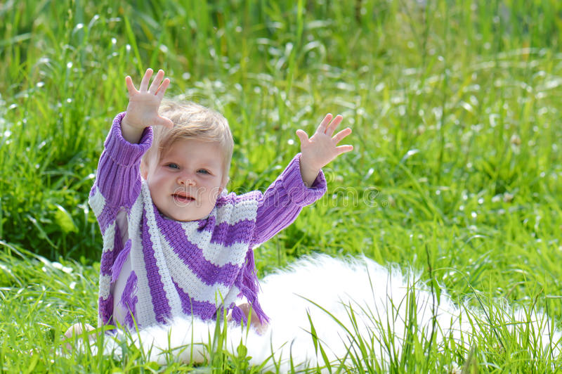 Infant girl. Infant baby girl up hands stock photo