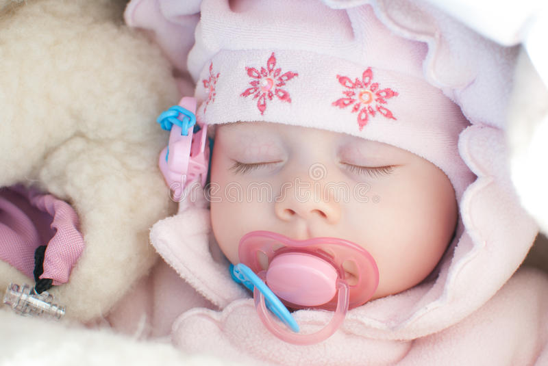 Infant girl on a winter walk royalty free stock image