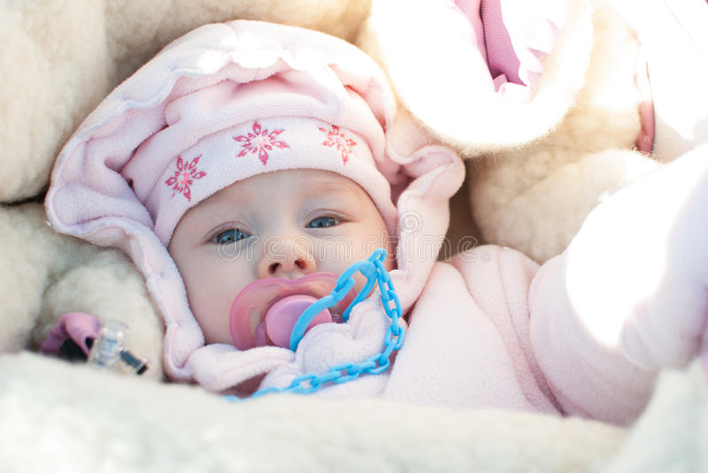 Infant girl on a winter walk stock image