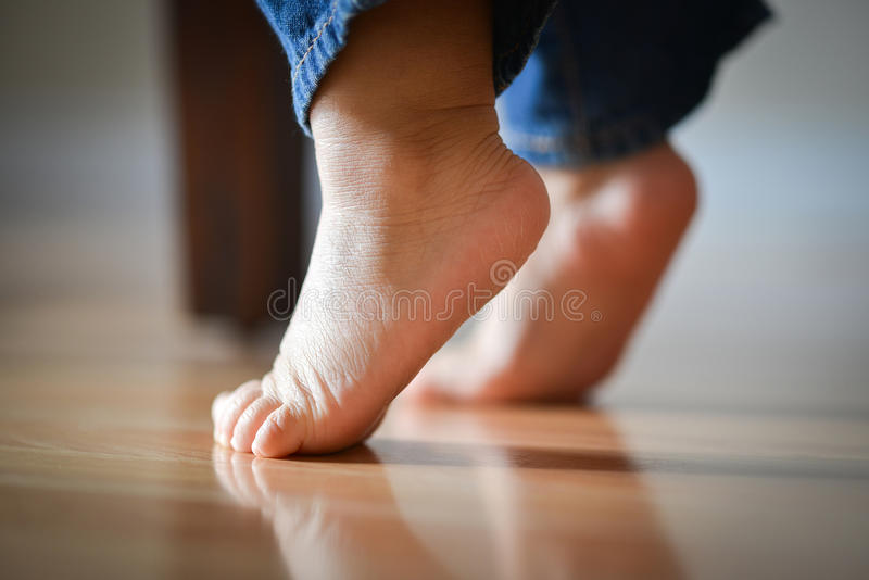 Infant's Precious Feet On Tippy Toes - Innocence Concept. Infant Child's Feet On Tippy Toes - Innocence Concept royalty free stock photo