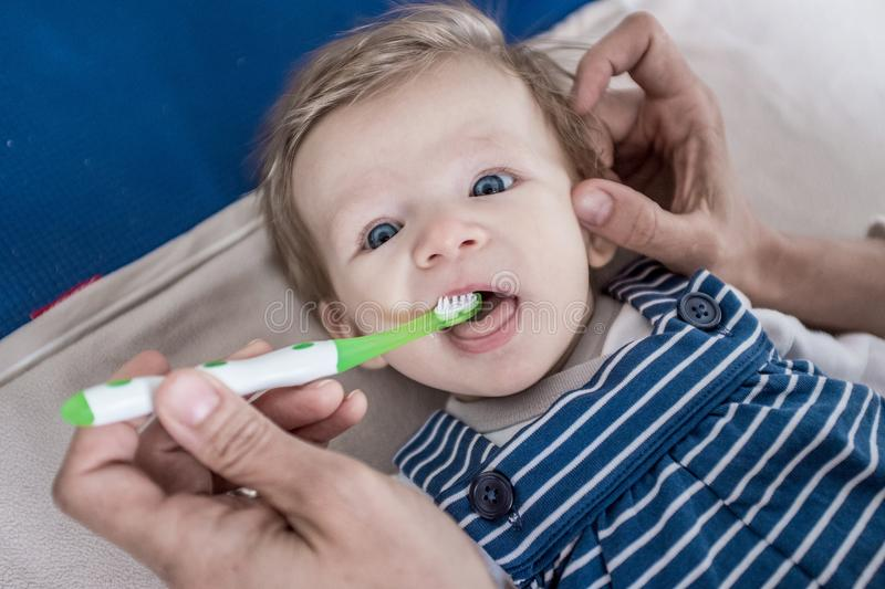 Infant teeth cleaning stock photos