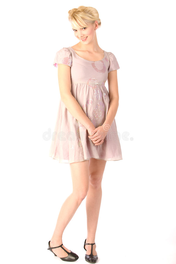 Infantile flirting blonde. In pink mini dress stock photography