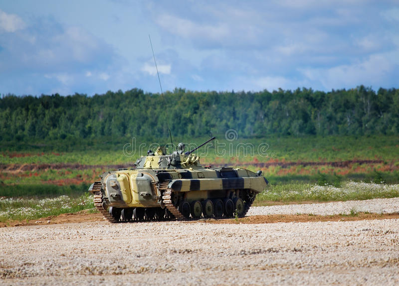 Infantry combat vehicle. On a boundary fire opening royalty free stock photography