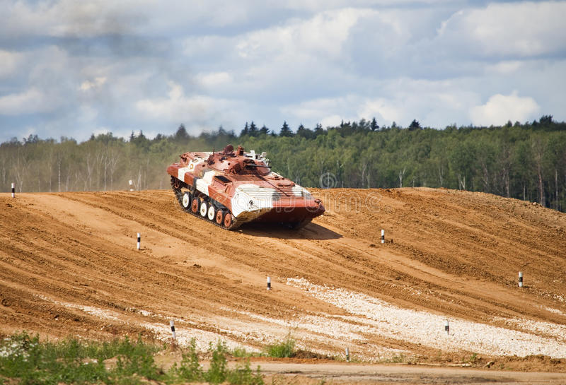 Infantry combat vehicle. On a march over rough terrain stock images