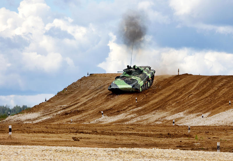 Infantry combat vehicle. On a march over rough terrain stock photos