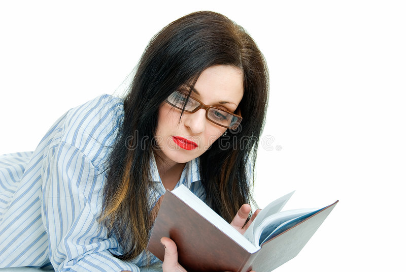 Infatuated woman. Young pretty woman read book with attentive stock photos