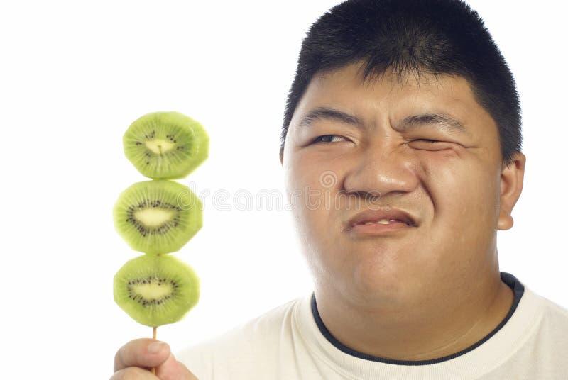 Infeliz com fruta de quivi verde fotos de stock royalty free