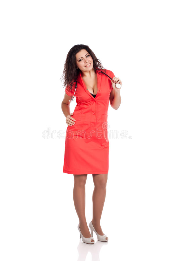 Infermiera attraente in arancio con lo stetoscopio fotografia stock