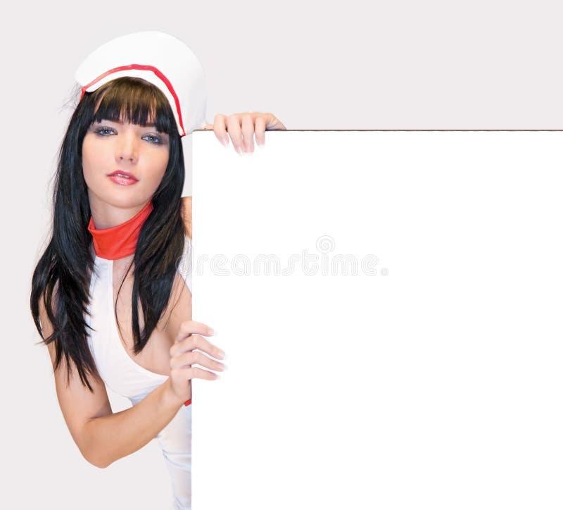 Infermiera con il segno in bianco fotografia stock libera da diritti