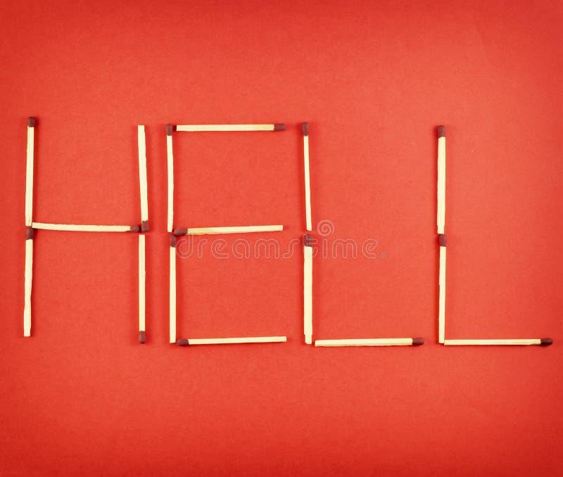 Infierno de la palabra hecho de matchsticks foto de archivo