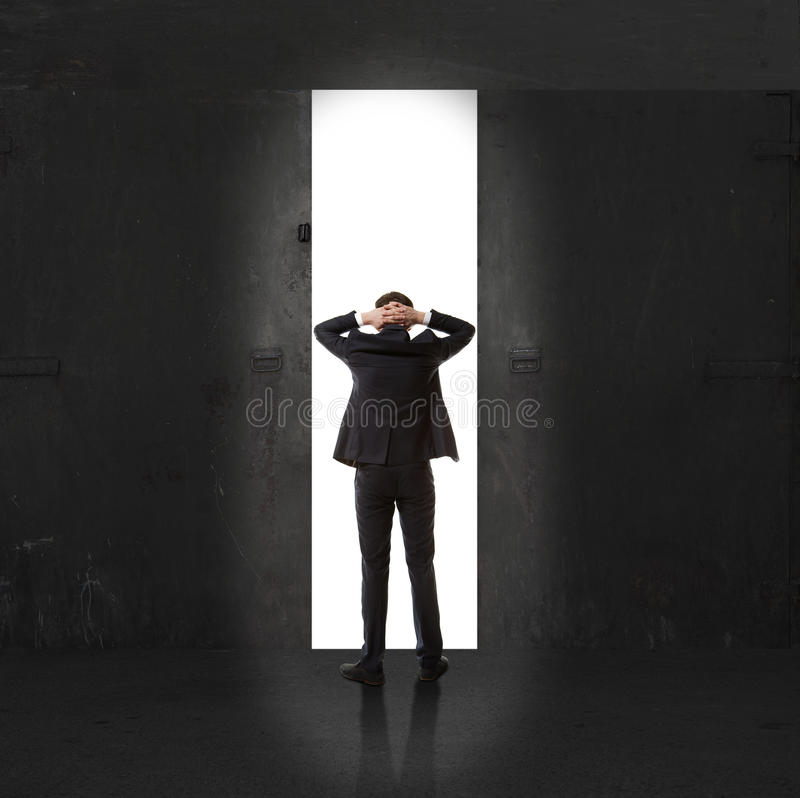 Infinidade Homem de negócios na luz da saída imagem de stock