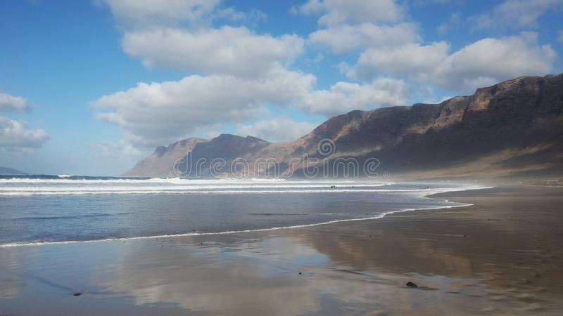 Infinite beach. The beach of Famara in Lanzarote Spain is one of the most spectacular of the island royalty free stock image