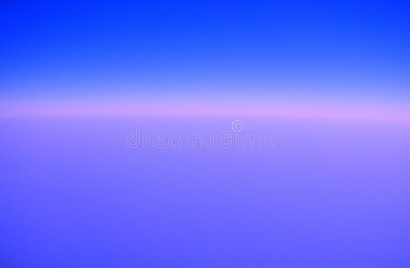 Infinite Pinkish Blue Sky Background. This background is created by processing an image of actual infinite sky captured while air travel stock photos
