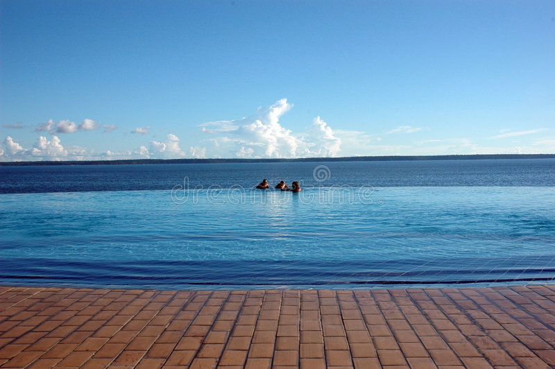 Infinite Pool. Infinite swimming pool, with Rio Negro in the background stock images