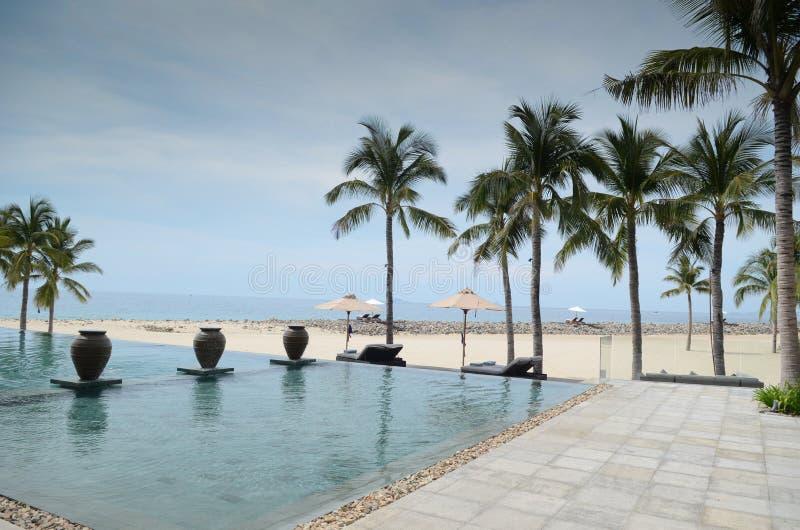 Infinite pool beach front resort. Nha Trang, Vietnam: infinite pool on the beach stock photo