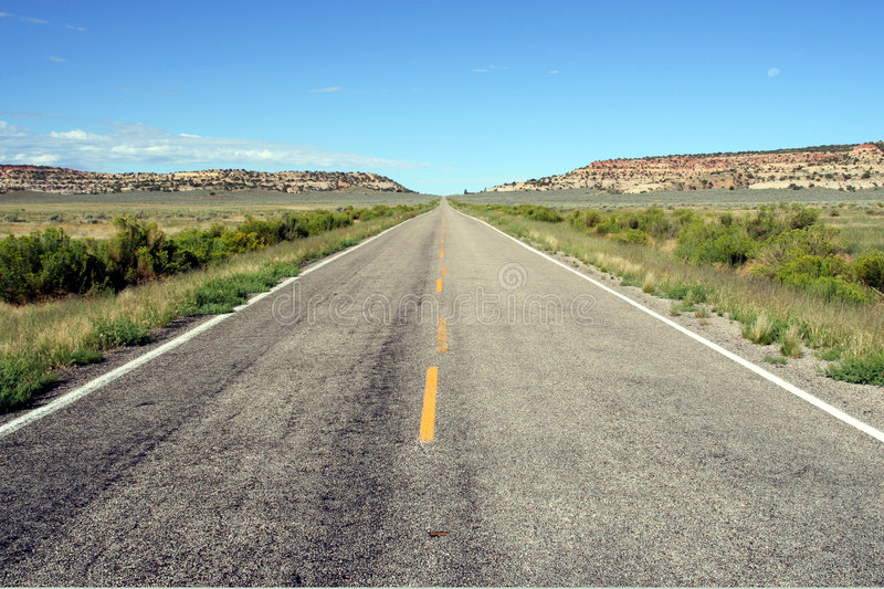 Infinite road. View of a infinite straight road in an American desert royalty free stock photography