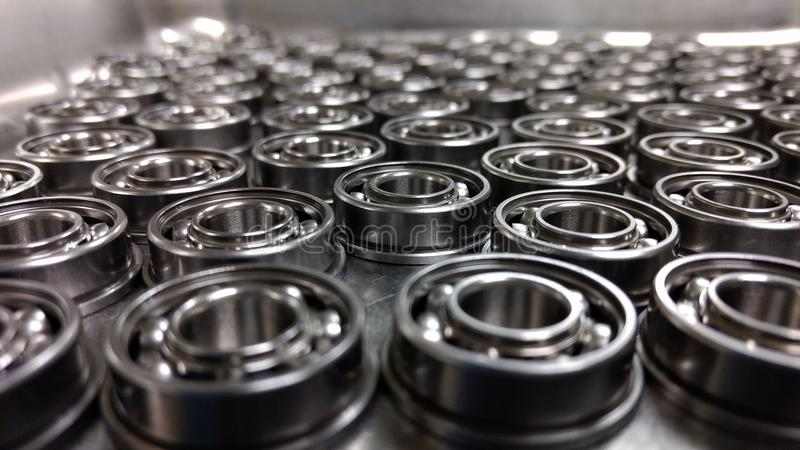 Infinity Bearings. A black and white infinity shot of bearings in a clean room stock photo