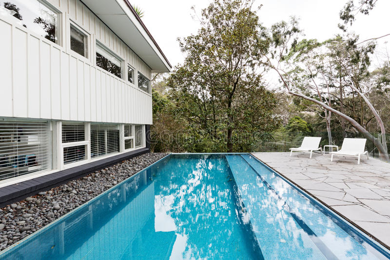 Infinity edge pool in backyard of mid century Australian home royalty free stock photos