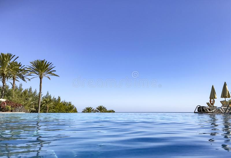 Infinity pool bright sunny day royalty free stock image
