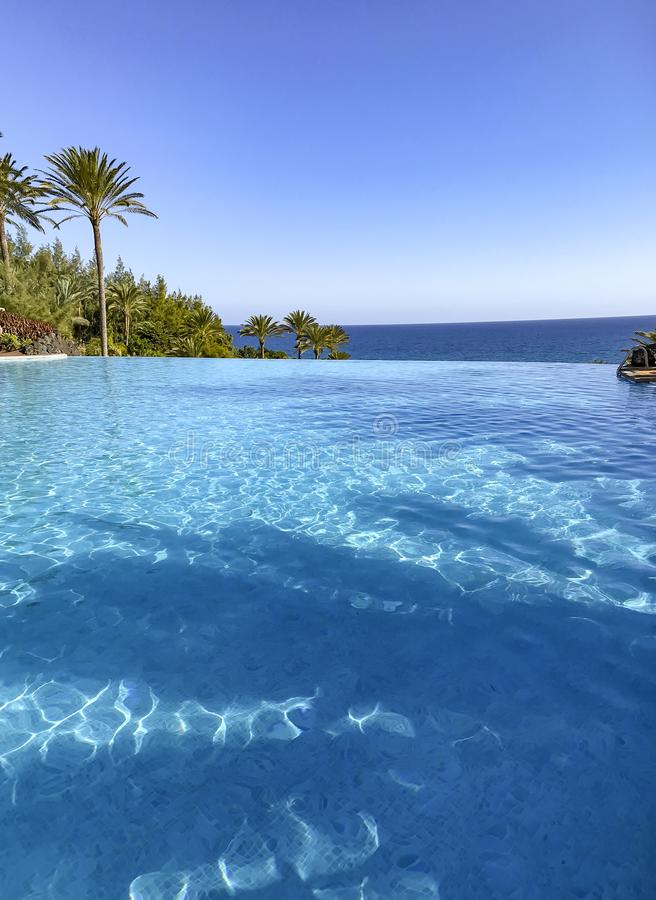 Infinity pool  bright sunny day stock images