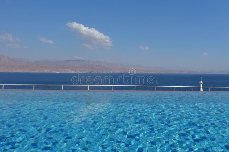 Infinity pool overlooking the Gulf of Aqaba royalty free stock photo