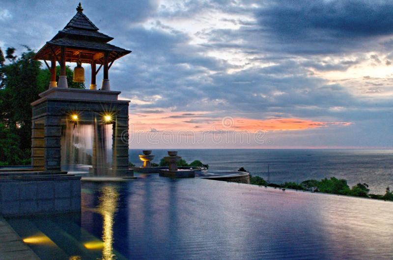 Infinity pool at sunset. Scenic view of infinity swimming pool on coast at sunset, Koh Lanta, Krabi, Thailand stock image