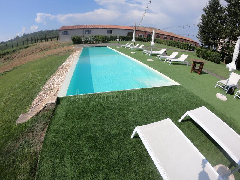 Infinity pool in Tuscany with vineyards stock photo