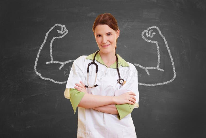 Infirmière avec des muscles de craie photos stock