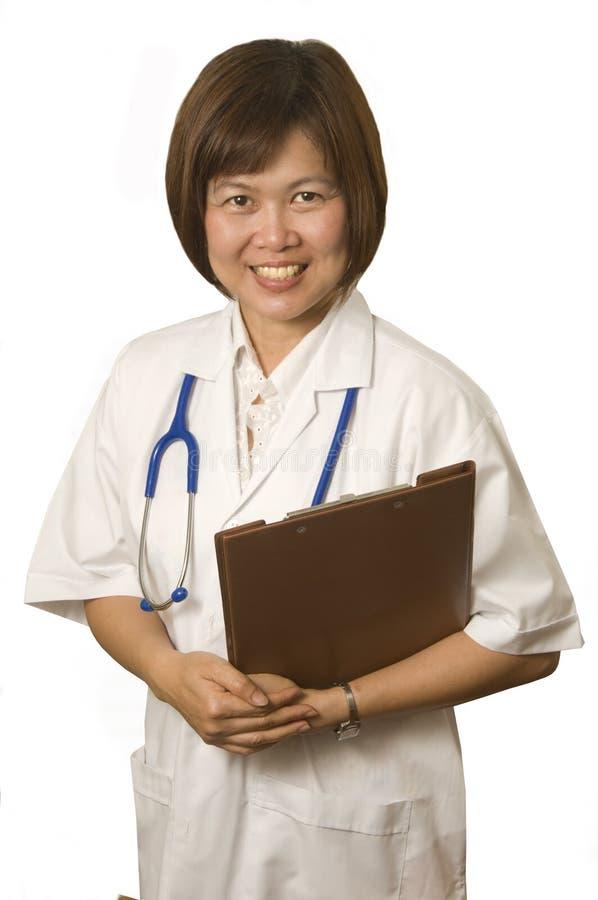 Infirmière avec la planchette photographie stock