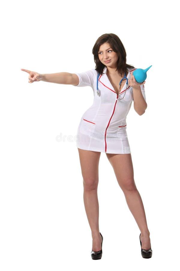 Infirmière avec le point d'enema laissé photo stock