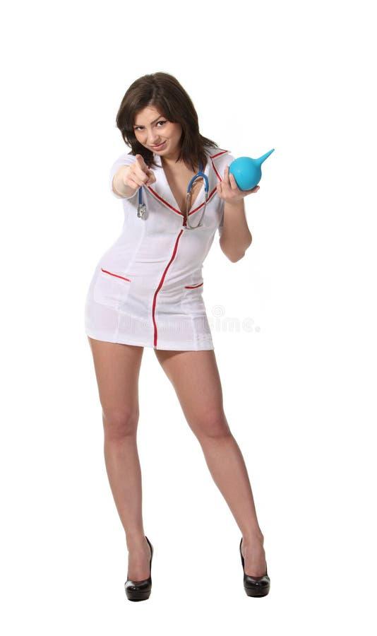 Infirmière avec le point d'enema vous images libres de droits