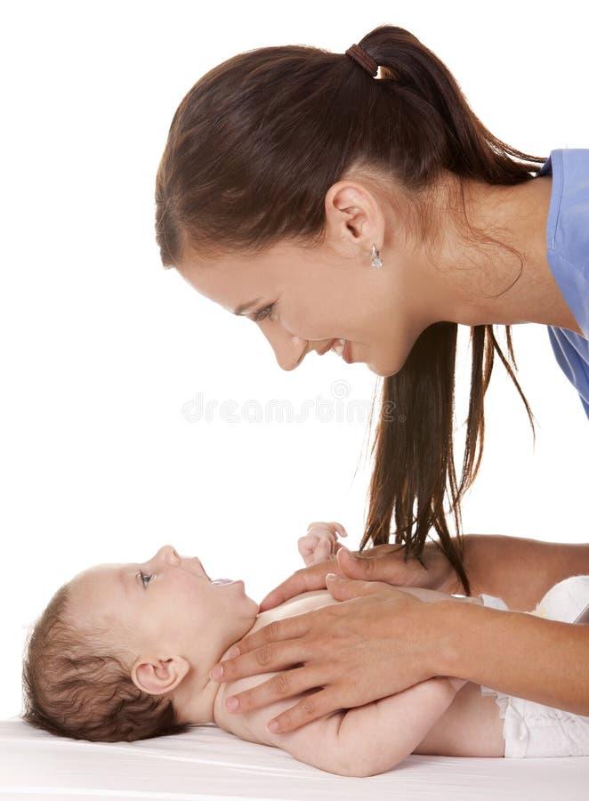 Infirmière féminine avec la chéri photos stock