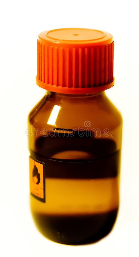 Inflammable. Detail of a small toned bottle with alcohol stock photo