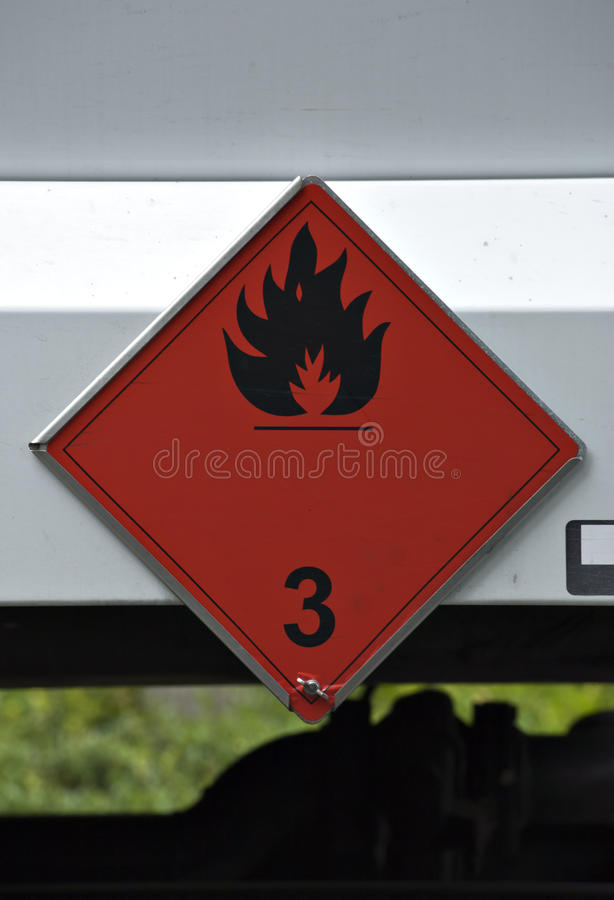 Inflammable goods sign on oil truck. Red inflammable goods sign on oil truck stock image