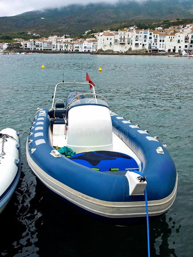 Inflatable boat. Blue motor inflatable boat in Cadaques, Costa Brava, Catalonia, Spain stock photo