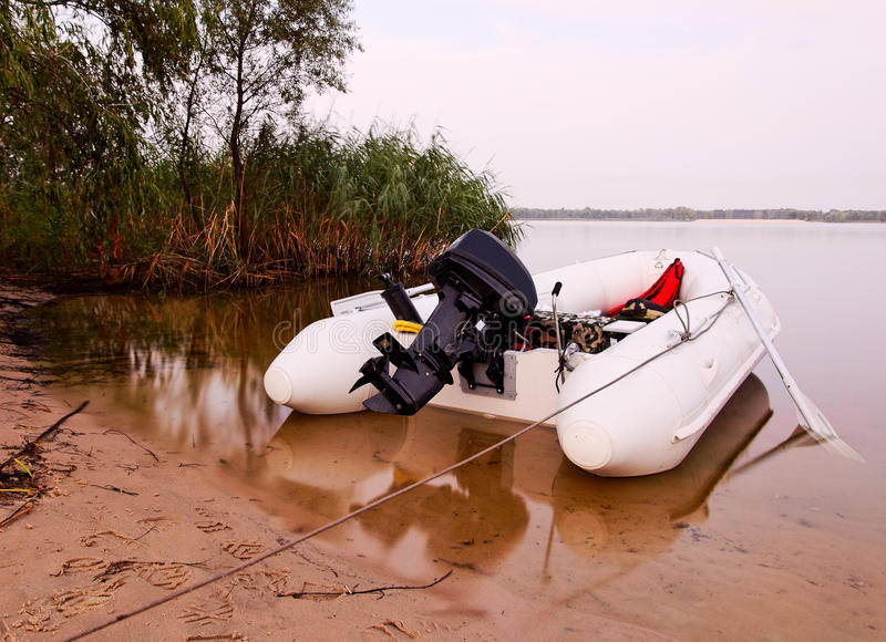 Inflatable boat. White Inflatable boat near coast royalty free stock photo