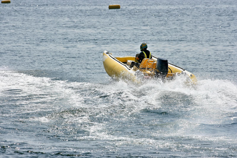 Inflatable boat. For speed on the lake stock image