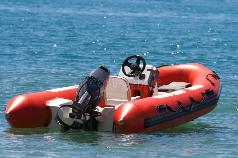 Inflatable boat. Transport theme: Inflatable boat on water royalty free stock image
