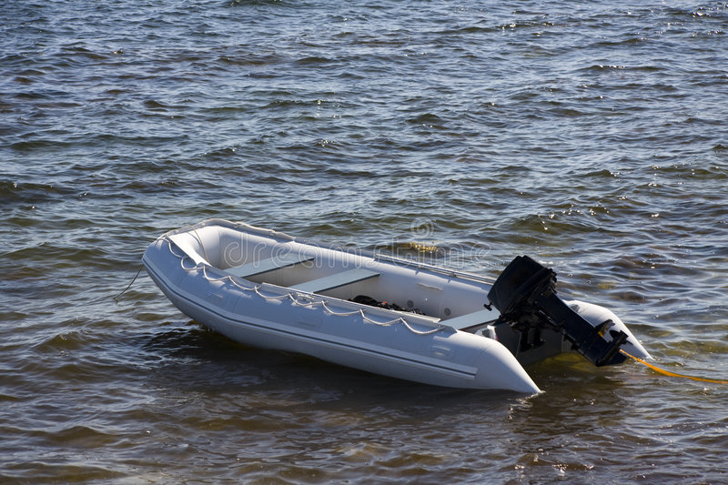 Inflatable boat. On the water royalty free stock photography