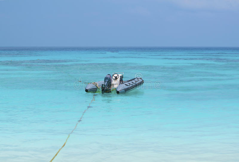 Inflatable boat. On blue sea stock photos